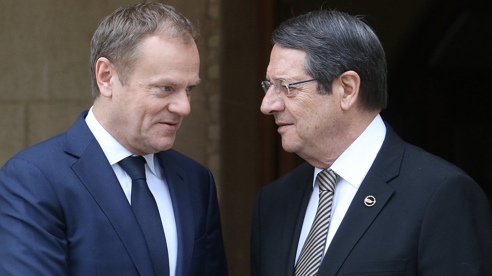 Cypriot President Nicos Anastasiades and European Council President Donald Tusk shake hands before a meeting at the presidential palace in Nicosia (15 March)