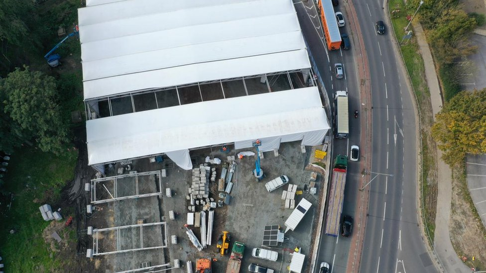 Aerial view of the tents being erected at Trinity Street burial ground