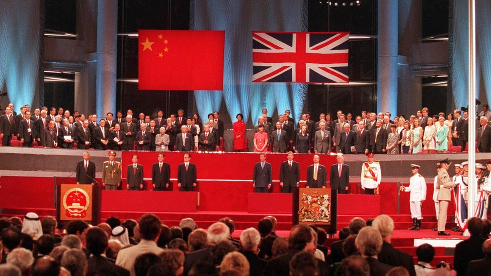 The handover ceremony showing the Chinese flag flying after the Union flag was lowered in Hong Kong in 1997