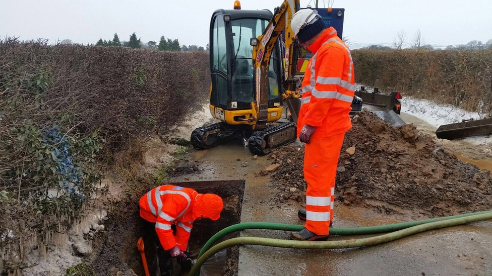 Thames Water staff fixing a pipe