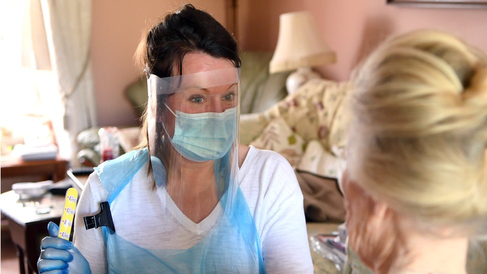 Right At Home care worker Sarah Cox does the nails of client Patricia Taylor at her home during the coronavirus pandemic