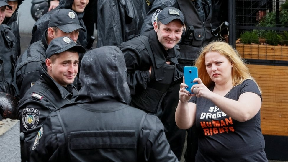 An activist takes a selfie with Ukrainian riot police