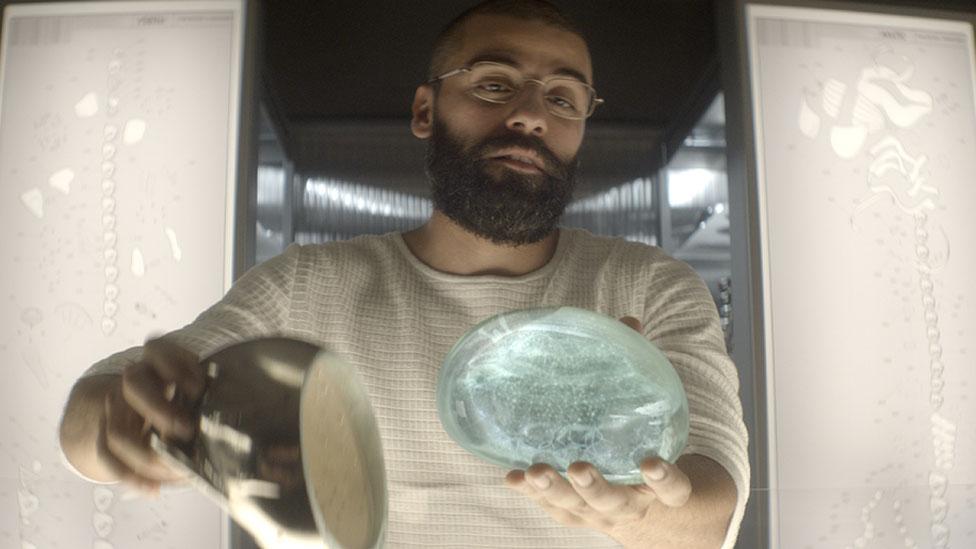 Conrad holds a robot 'brain'
