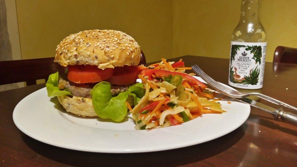 Ganesh's choice of a homemade burger for dinner.