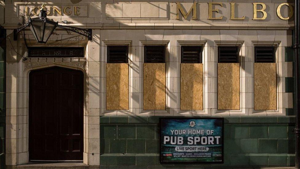 Shuttered windows of a closed pub
