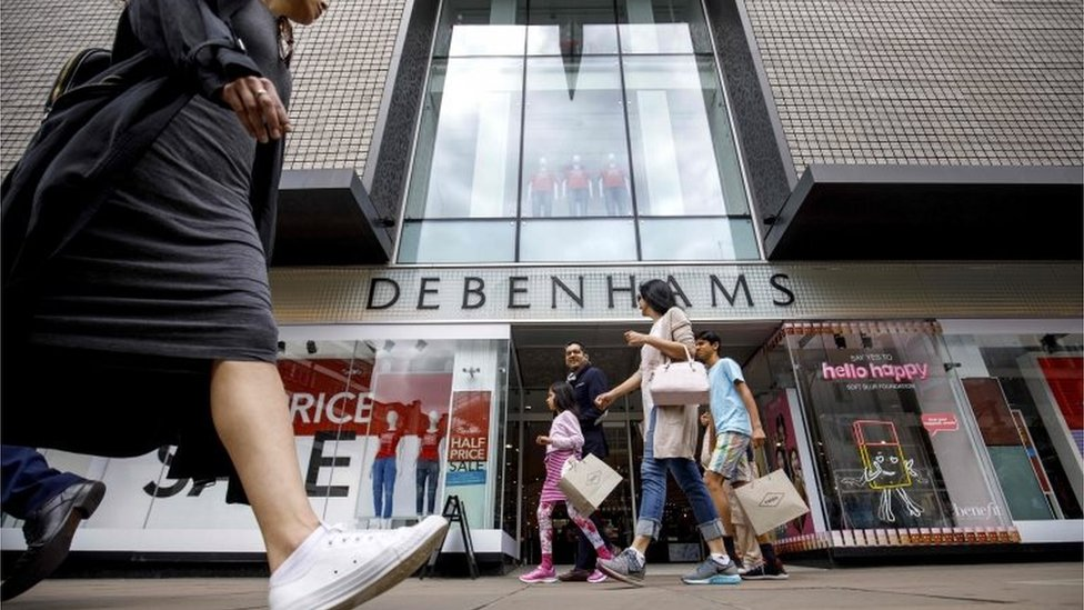 Woman walking past Debenhams
