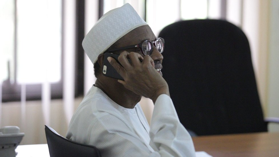Muhammadu Buhari speaking on the phone to Goodluck Jonathan after winning the Nigerian presidential race, 31 March 2015