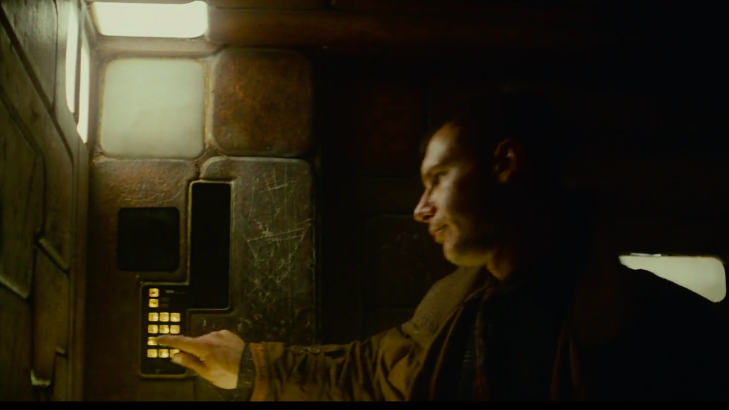 Deckard enters a lift in his home