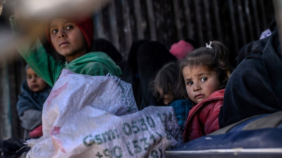 Islamic State group: Civilians evacuated from last Syria enclave