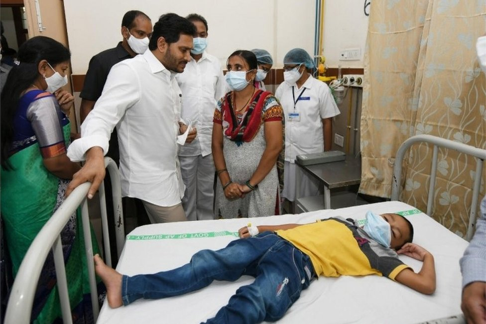A handout photo made available by the Andhra Pradesh Government on 07 December 2020 shows the Andhra Pradesh Chief Minister Y.S. Jagan Mohan Reddy (C-L) meeting with the patients going under treatment for an unknown disease that left over 200 people hospitalised in Eluru town, Andhra Pradesh, India, 06 December 2020