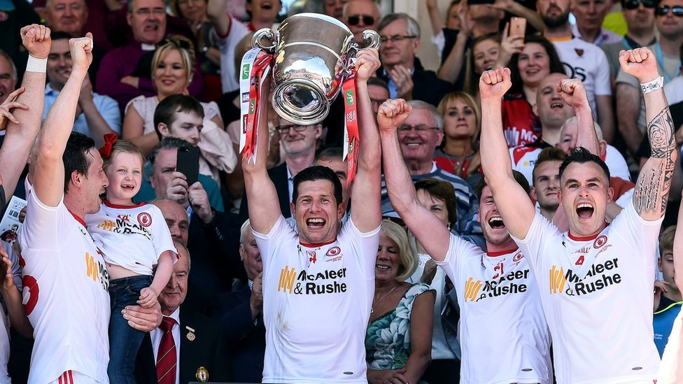 Seán Cavanagh holds aloft the Anglo-Celt Cup in 2017