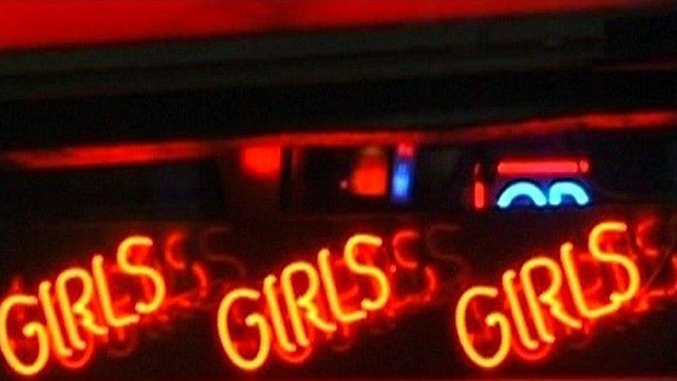 Lap dancing sign