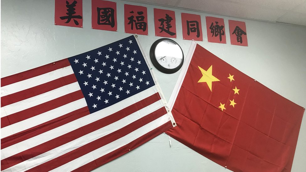 A Chinese and American flag on the wall of the Fujianese association