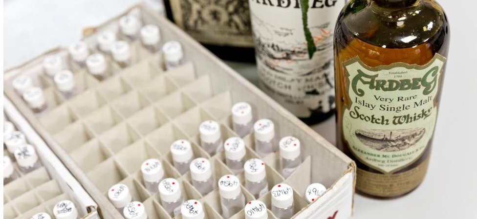 Scotch whisky bottles at Suerc laboratory