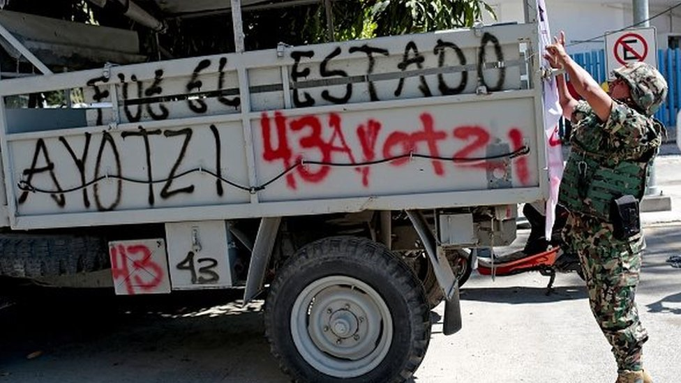 A soldier remains next to a military vehicle after a protest demanding justice and clarification of the disappearance of 43 students from Ayotzinapa, on 12 January, 2015.