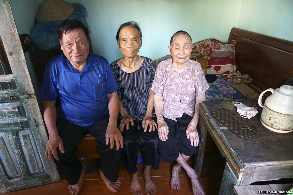 Pham An Thic (left), 74, his wife Nguyen Thi Lai (center), 76, and his mother Pham Thi Dau, 95, at their home in Hai Duong