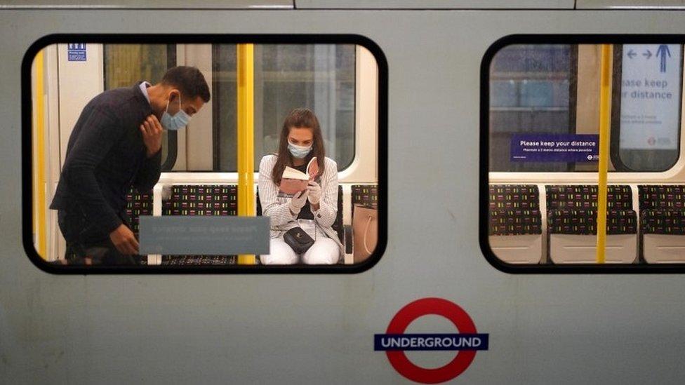 People wearing masks on Tube