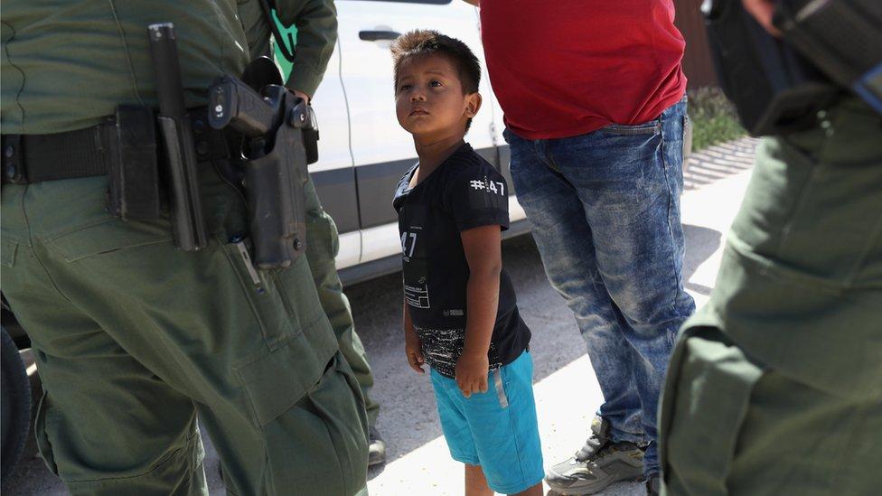 Border patrol agents detain migrants near US-Mexico border, 12 June 2018
