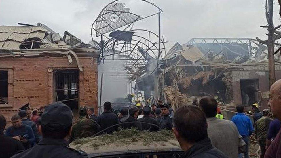 Crowds look at destroyed buildings in Ganja. Photo: 4 October 2020
