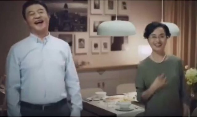 A screengrab from the scrapped Chinese Ikea advert showing the woman's parents beaming at her unexpected boyfriend