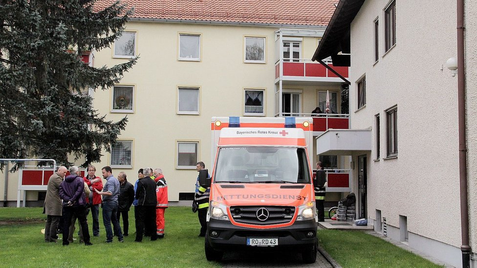 An ambulance stands by the entrance to an apartment building on April 19, 2016 in Rosenheim