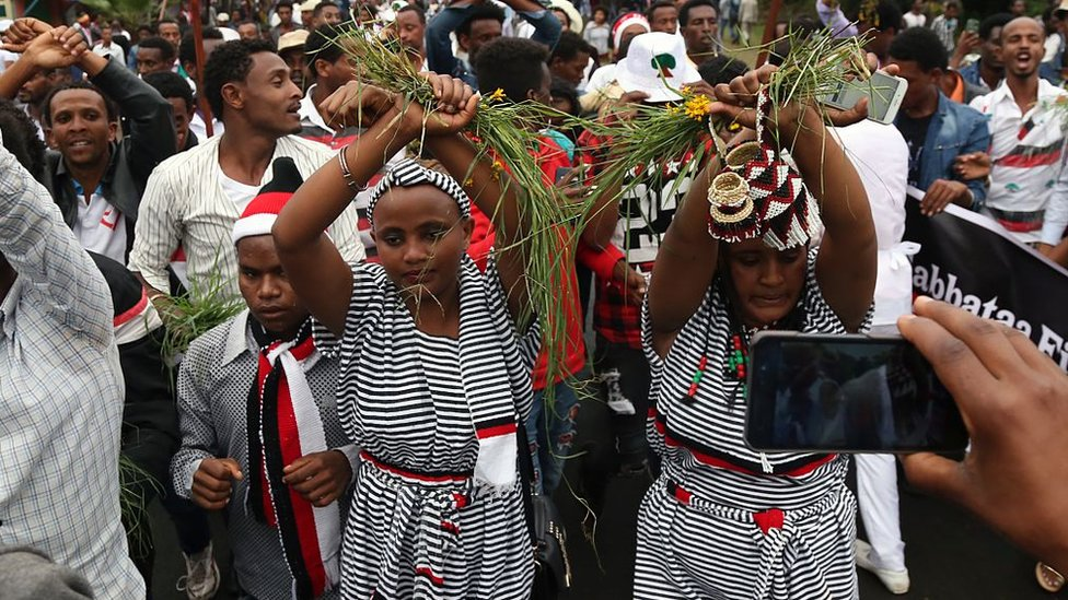 Oromo people stage a protest against government during the Oromo new year holiday Irreechaa' near the Hora Lake at Dberzit town in Addis Ababa, Ethiophia on October 2, 2016