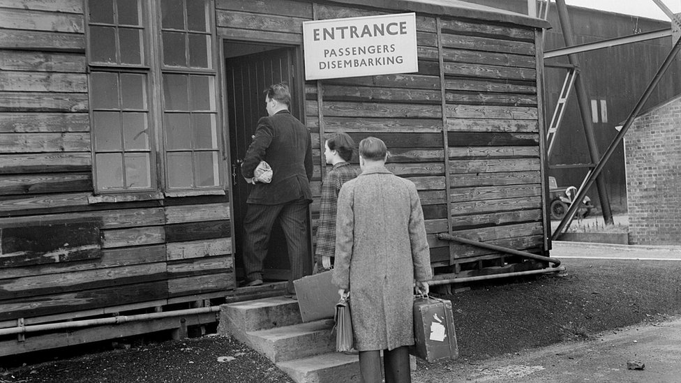 Passengers queue for customs at Luton Municipal Airport in 1951