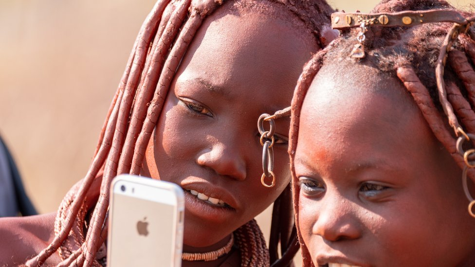 Two girls from the Himba tribe near Outjo, Northern Namibia