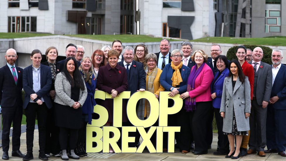 Scottish National Party candidates, including SNP Westminster leader Ian Blackford (centre) and Party leader Nicola Sturgeon (centre left), with a stop Brexit message at the party's General Election campaign launch in Edinburgh.