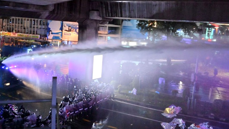Police use water cannons to disperse pro-democracy protesters during an anti-government rally in Bangkok on October 16, 2020