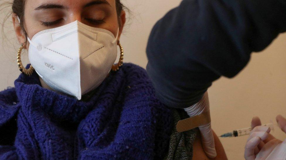 Woman receiving Covid vaccine