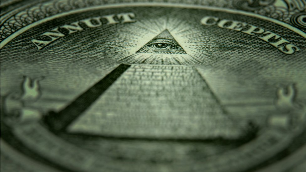 A close-up of the back of a one dollar bill with a symbol associated with secret societies.
