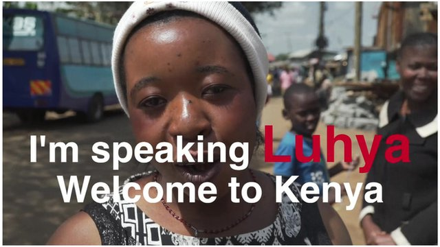 Woman in Kenya with text on top saying 'I'm speaking Luhya - Welcome to Kenya'