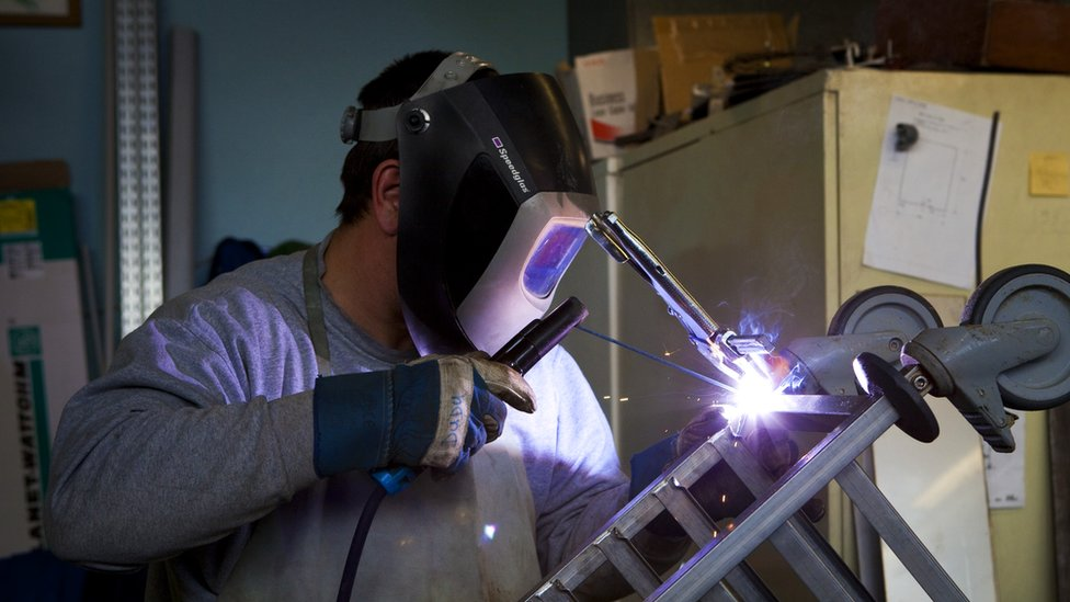 File pic of a worker welding
