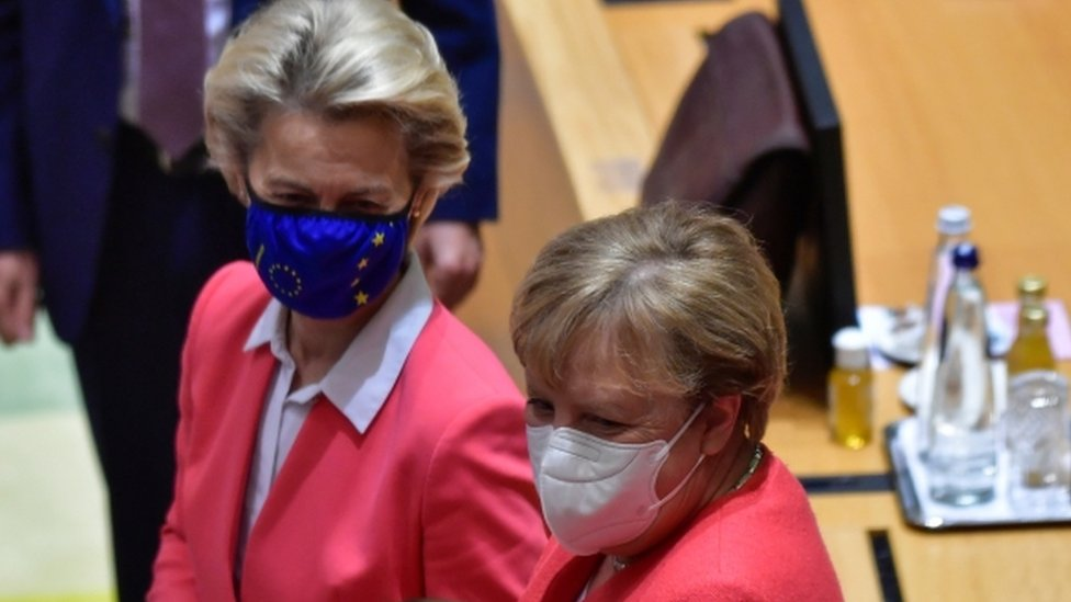 German Chancellor Angela Merkel speaks with European Commission President Ursula von der Leyen