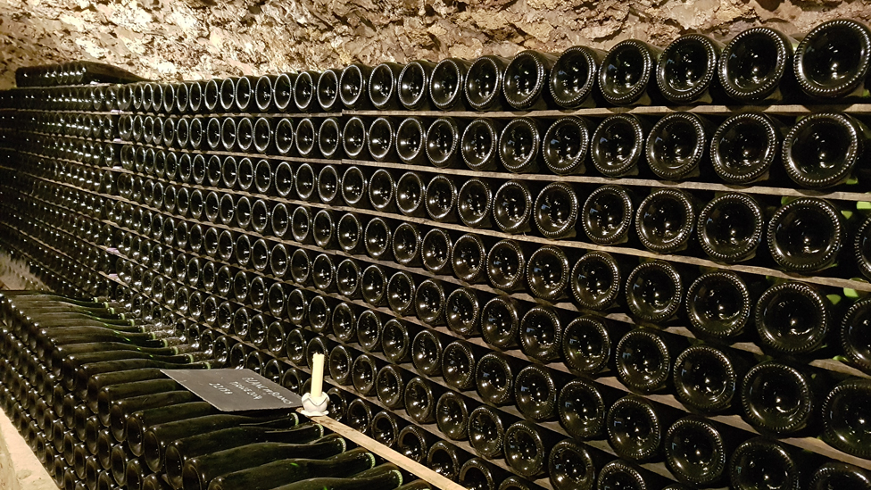 Champagne lying in racks in the cellar