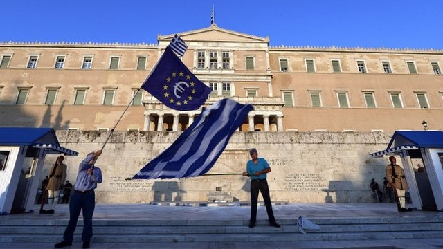 Flags waved outside parliament in Greece