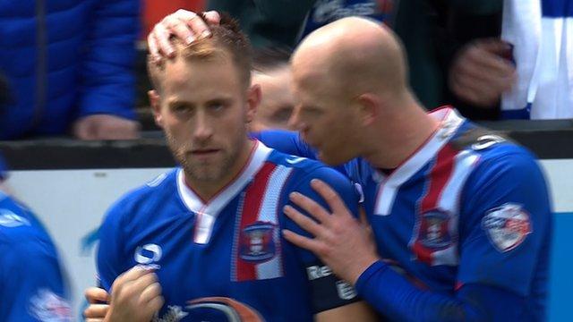 Danny Grainger scores from the penalty spot for Carlisle