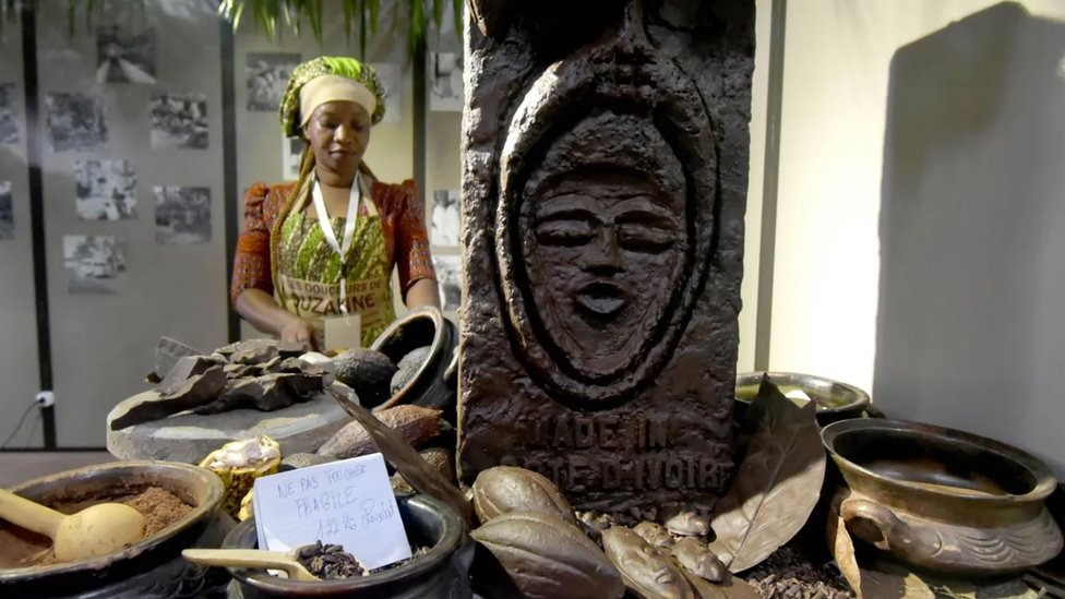 A woman at a cocoa exhibit