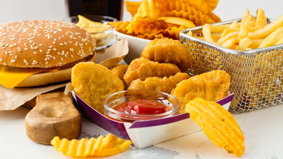 Assortment of fast food including chips and burgers