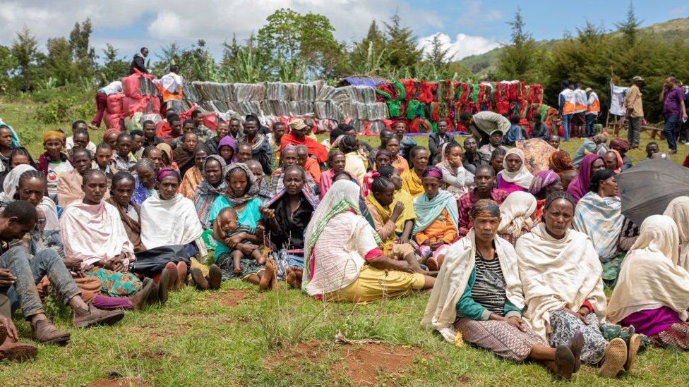 A group of Internally Displaced People ( IDP ) waits for aid distribution near their shelters on May 20, 2019 at Qercha village, Southern Ethiopia