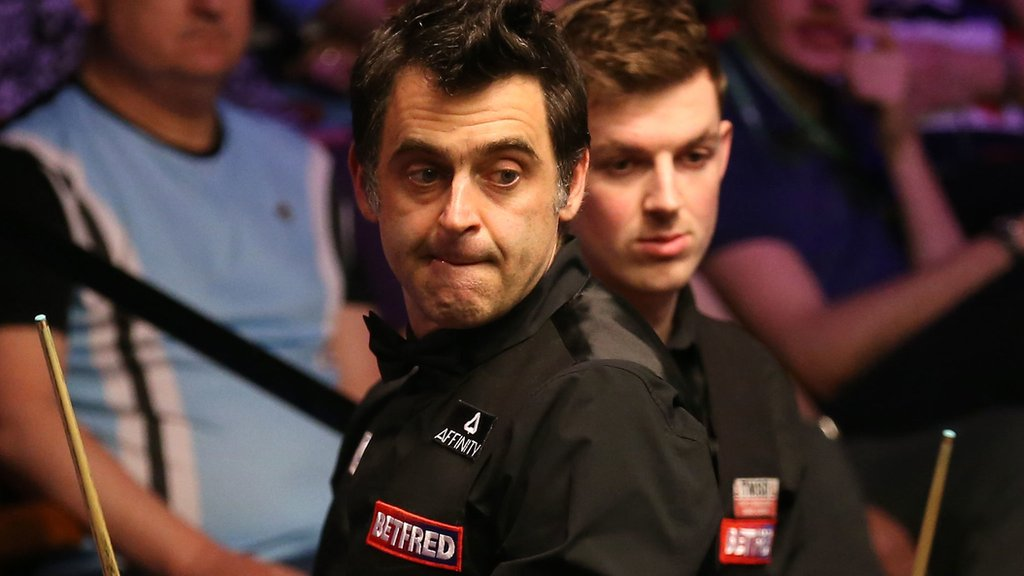 World number one O'Sullivan trails amateur Cahill