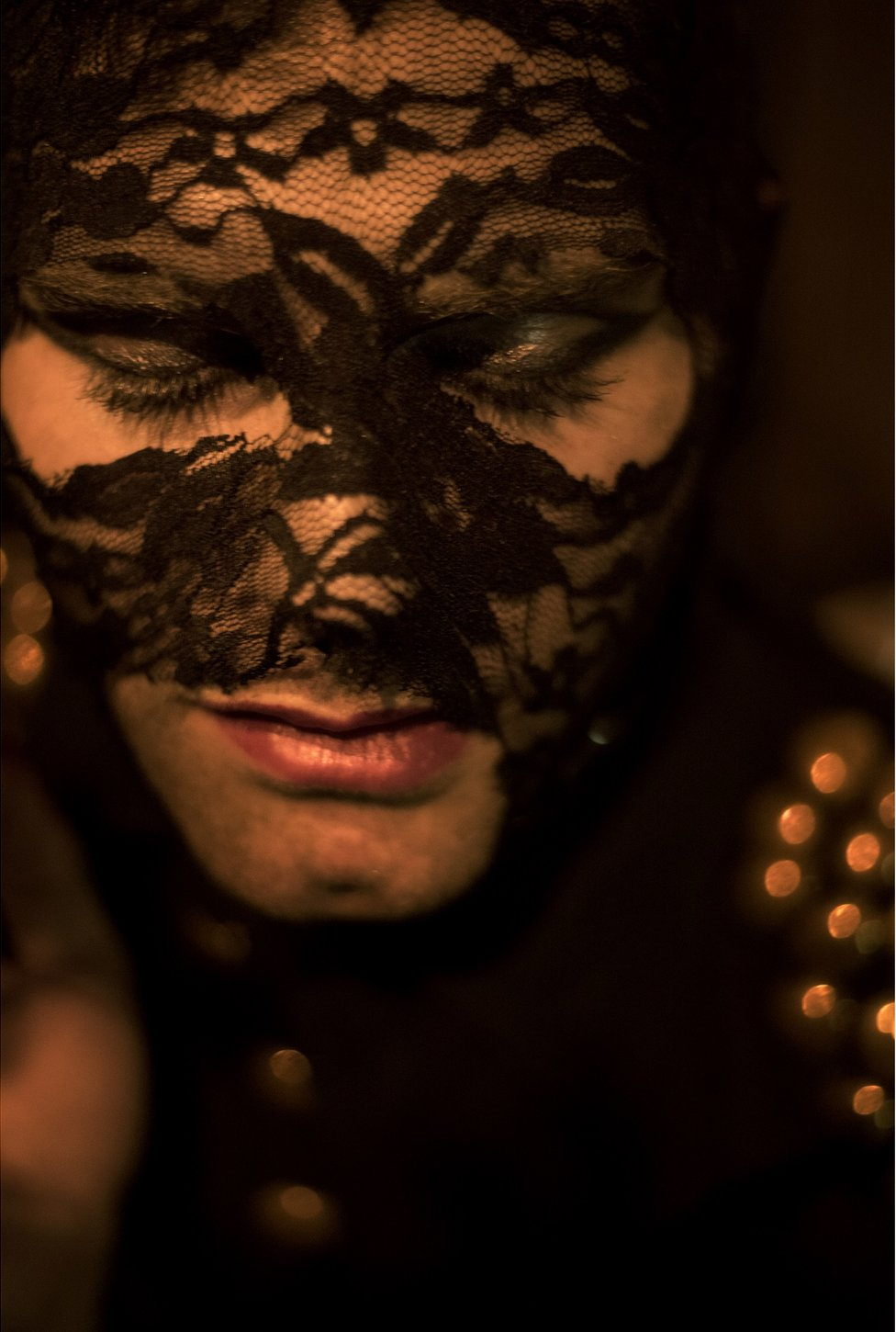 Elias poses with lace over his face