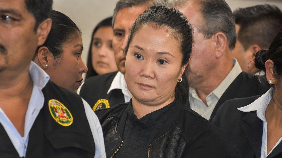 Keiko Fujimori (C) is detained
