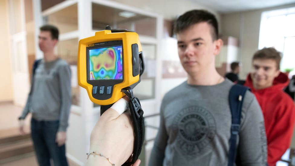 Checking students' body temperature with thermal imaging cameras at the entrance to Ryazan State Radio Engineering University during the COVID-19 coronavirus pandemic.