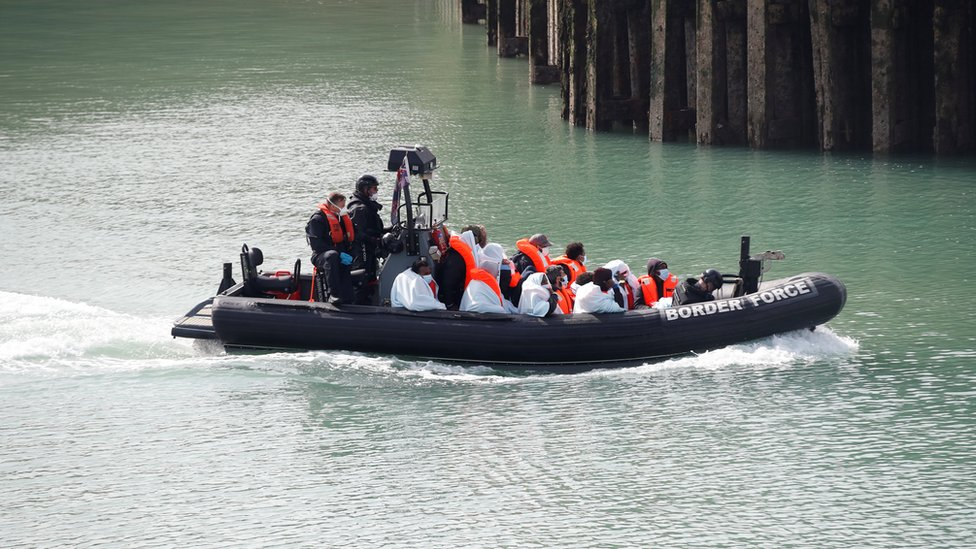 Border Patrol agents bring migrants into Dover harbour on a boat, after they tried to cross the channel, in Dover, Britain, September
