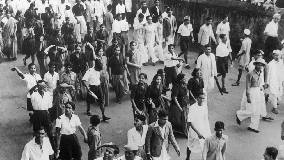 Women volunteers from Congress walk through the streets of Bombay shouting slogans during disturbances in the city.