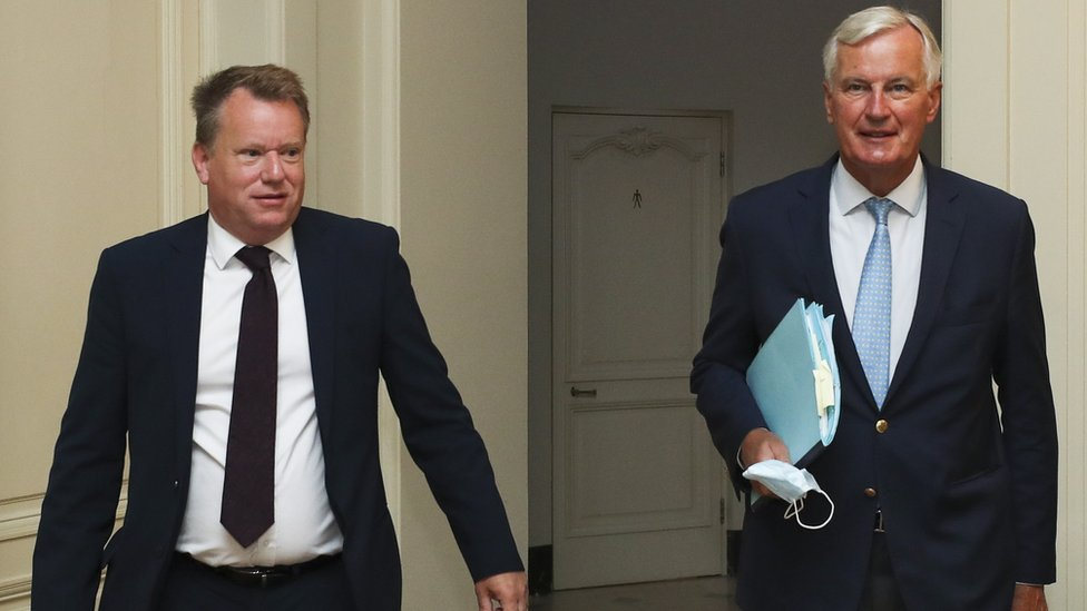 Lord Frost, the UK's chief Brexit negotiator, and his EU counterpart Michel Barnier, arrive for a meeting, in Brussels in August