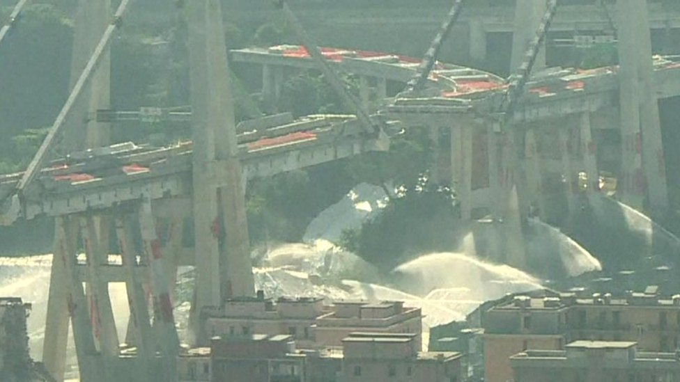 Fountains of water sprayed the base of the structure before the blasts