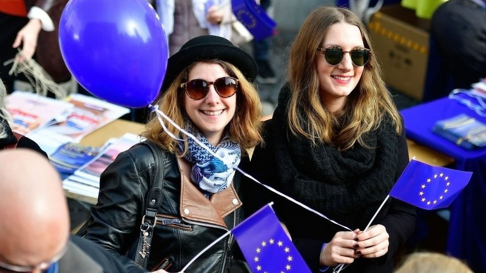 Young women waving flags of the European Union gather in the city centre for a pro-EU demonstration of the 'Pulse of Europe' movement on March 12, 2017 in Frankfurt, Germany. The movement sprung up in 2016 after the Brexit referendum result and the election of U.S. President Donald Trump